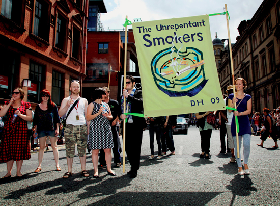 Jeremy Deller, Procession [detail], 2009, 'The Unrepentant Smokers', featuring banner designed by David Hockney and made by Ed Hall. Image courtesy the artist.
