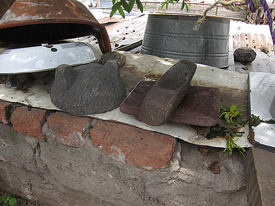 Two reused pre-Hispanic mortars in the house of a neighbor